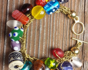 Multicolored Glass Beads Red Blue Yellow Puprle Gold Tone Handknitted Bracelet by hipknitta