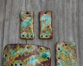 A wonderful mix of Worldly colors on blues, green and browns, a 4 piece set in handmade pottery