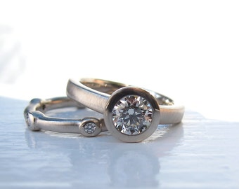 18kt palladium white gold .65ct KVS1 solitaire with diamond scatter eternity wedding band