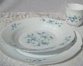 12 Pieces Arcopal milk glass, 'Veronica' pattern, with blue flowers Set includes 4 each Dinner Plates, Large Rim Soup Bowls, and Coffee Cups