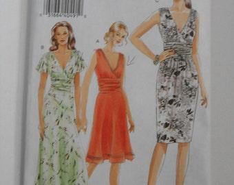 Vogue V8182 V Neckline Dress Pattern Size 6 8 10 Bust 30 1/2 31 1/2 32 1/2 UNCUT