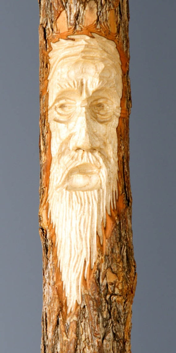 Walking stick with leather wrap and hand carved tree spirit