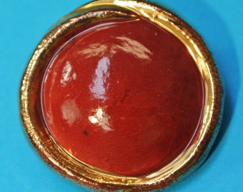 Rare large vintage 1950s HANDMADE round dark cherryred ceramic button with goldcolor frame and backside selfschrank for your sewing prodject