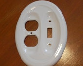 White Oval Glossy Ceramic single switch and outlet socket plate