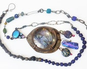 Your Astonishing Light. Cosmic rustic Victorian tribal assemblage iridescent blue necklace with geisha.