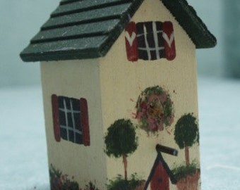 Handmade miniature wood birdhouse for the garden
