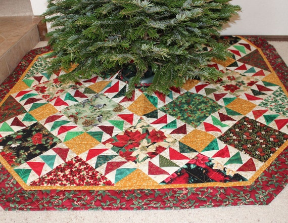 Large christmas tree skirt quilt with birds and poinsettias in