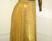 redefinding timeless style in this vintage 60s/ 70s gorgeous gold and black metallic knit dress sz s