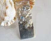 Handcrafted Topaz Pendant: Three Blue Stones