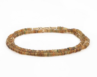 necklace of brown-green tourmaline and gold