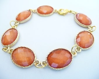 Gold Plated Oval Bracelet with Orange Faceted Glass Beads