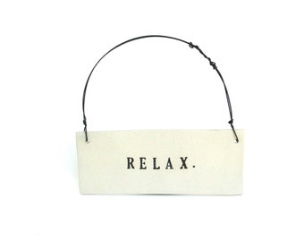 relax    ...   inspiring tag   ...   hanging porcelain sign