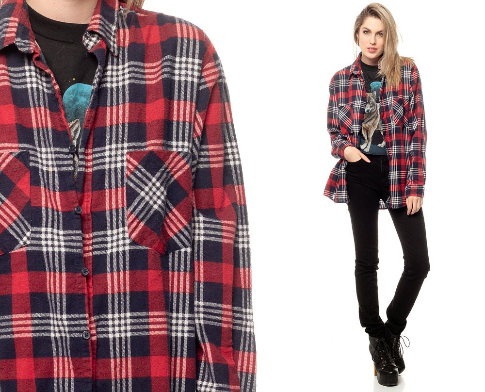 Soft, cotton flannel, with a red and navy blue plaid print, forms this comfy shirt dress with a collared neckline, and long sleeves with button cuffs. Shift bodice has a full button placket, front patch pockets, and slight high-low hem/5(7).