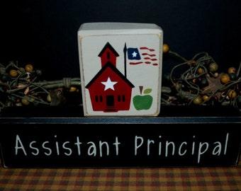 Assistant Principal primitive wood blocks sign