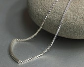 Long curved pendant necklace on a sterling silver chain. Everyday simple, modern and minimal necklace.