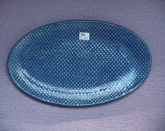Oval, ceramic platter, blue, glossy, and textured