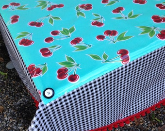 Retro round oilcloth tablecloth with cherries on seafoam green and black gingham