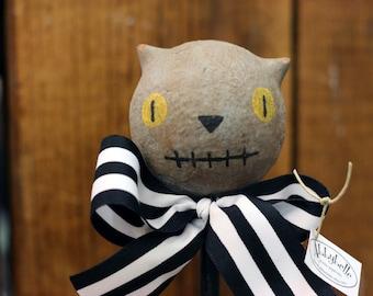 Gray Stitchmouth Cat on a Stick
