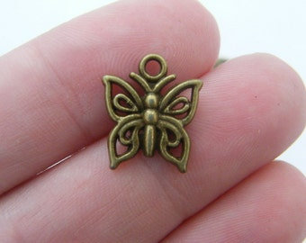 12 Butterfly charms antique bronze tone BC118