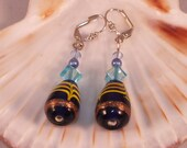 Silver dangle earrings with blue Indian glass beads