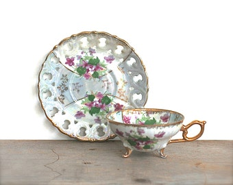 Teacup And Saucer, Inarco Vintage Japan Footed Teacup Lusterware Soft Blue Violet Flowers Gold Edge Pierced Rim
