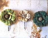 Three flower pins. Casual elegance to any hairstyle. Greens and cream bobby flower pins.