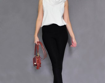 NECK .. White Sleeveless Turtleneck Blouse