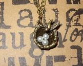 Antique brass bird nest necklace, tiny pearls in nest