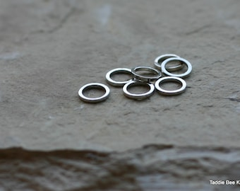 Seven stitch markers, stainless steel, rings for knitting (small)