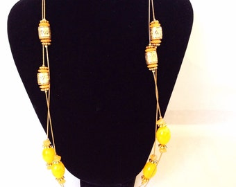 Very long gold chain necklace with spaced orange beads  costume jewelry