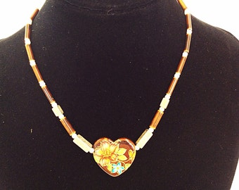 Vintage heart necklace with flower motif choker length signed Japan on gold clasp