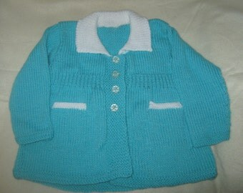 a green and white baby coat with pockets