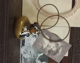 photo/note holder, antique door knob, table top decor, altered art, rusty wire, embellishments