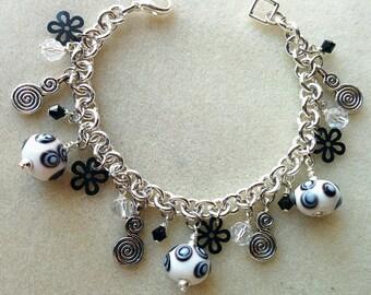 Swirls and flowers charm bracelet