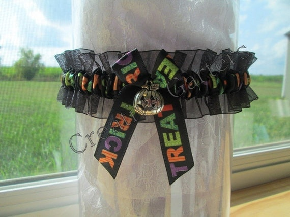 Halloween wedding garter with cute little pumpkin charm and trick or treat ribbon
