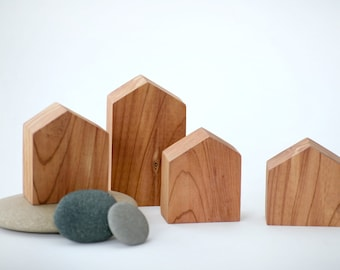 Set of 4 tiny wooden houses. Cut from red cedar.