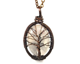 The Crystal Clear Quartz Stone Tree of Life Necklace in Antique Copper.