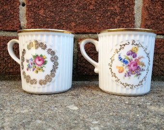 White floral mugs with gold trim