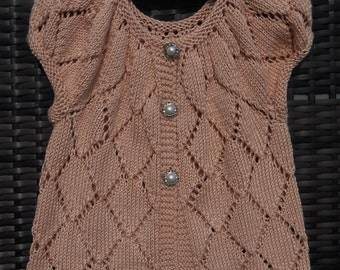 Cardigan/sweater/jumper for a baby girl/toddler age 2-3 yrs. Hand knitted in pinky peach bamboo and silk yarn