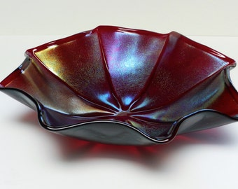 Large Fluted Iridescent Fused Glass Bowl, Garnet Red Translucent with Multicolored Iridescent Surface.