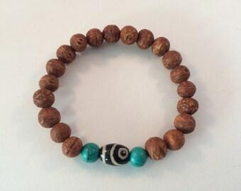 Tibetan Mala Raktu seed wrist mala bracelet with turquoise and dzi beads