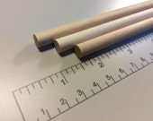 "FIVE 5/16"" wooden dowel rods"