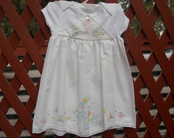 Handmade baby dress with vintage materials