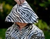 Girl's raincoat; zebra-print size 4