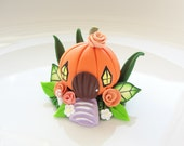 Miniature pumpkin house fairy cake topper made from polymer clay