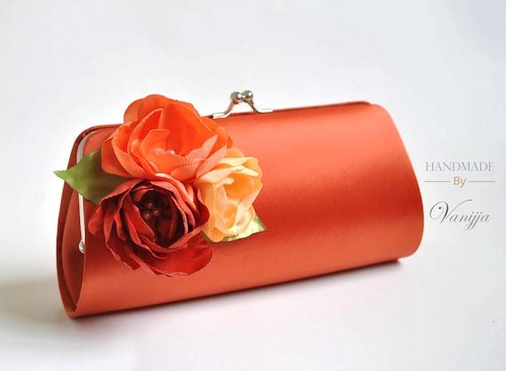 burnt orange clutch with shades of orange flowers fall
