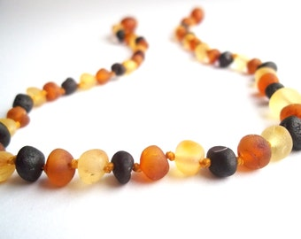 Maximum Effective Raw Unpolished Baltic Amber teething necklace for your baby handmade knotted .Multicolor amber.