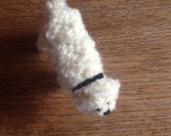 Knitted curly cream Poodle