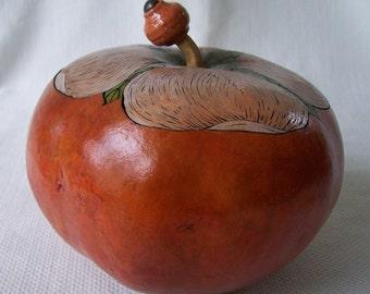 Medium rust gourd box with single dogwood flower lid. 1758.