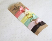 Banana Split No Crease Fold Over Elastic Knotted Hair Tie Bracelets in Coral, Cream, Yellow, Mint, Light Pink, and Chocolate Brown
